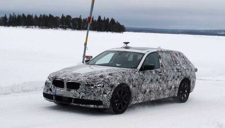 BMW Serie 5 Touring nuova generazione, le foto spia sulla neve (5)