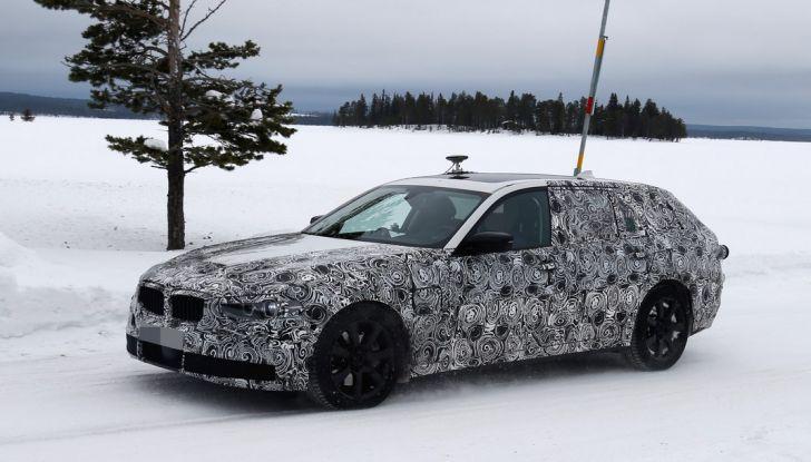 BMW Serie 5 Touring nuova generazione, le foto spia sulla neve (6)