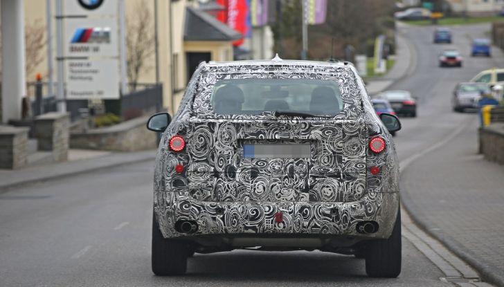 BMW X5 di nuova generazione, le immagini spia dei test in pista - Foto 9 di 13