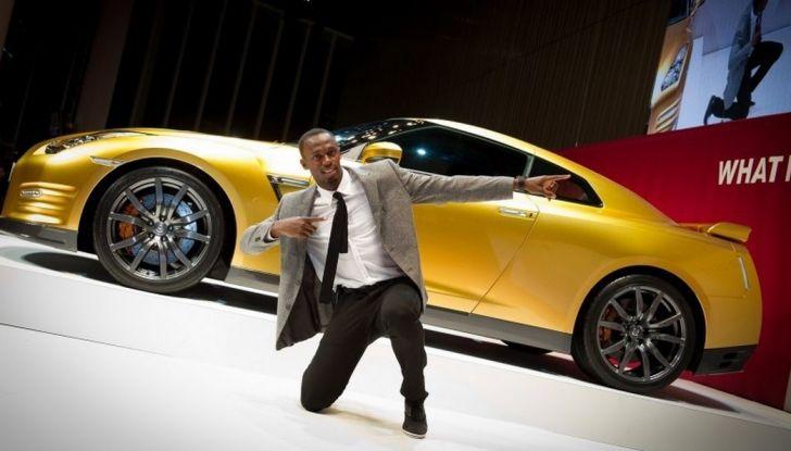 Usain Bolt, 6 volte medaglia d'oro alle Olimpiadi, sfida il fuoco - Foto 1 di 9