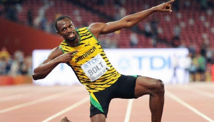 Usain Bolt, 6 volte medaglia d'oro alle Olimpiadi, sfida il fuoco - Foto 3 di 9